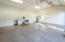 800+ SF with 12+ Ft tall ceilings. Water, Gas, Electric & Sewer all available for ADU conversion