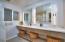 Downstairs updated bathroom with custom vanity