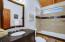 Hallway bathroom with tub, upper level.