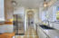 Charming cottage style kitchen with arched door way to laundryroom.