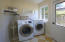 Laundry room with access to sideyard.