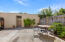 Sunlit patio with access to carport and garage.