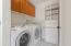 Laundry area off kitchen.