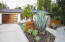 Custom wood garage door, new drought tolerant landscaping, irrigation, drainage.