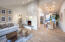 Venetian plaster fireplace, new oak hardwood, designer chandelier.