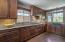"Custom cabinetry, ""eco"" counter tops, granite farmhouse sink, cork flooring, dual ovens."