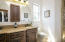 Dual sinks and custom cabinetry.