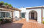 Entertain or relax in the gated courtyard with trellised patio.