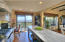 Kitchen to outside slider and views.