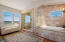 Elegant bathroom with separate shower and soaking tub!