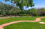 Surrounded by trees providing privacy for entertaining and backyard events.