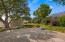 Upper patio for entertaining or quiet retreat space under a mature live oak.