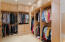 Custom closet with tons of storage and organization space.