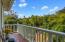 Entry-level balcony overlooks trees