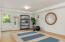 Downstairs finished bonus space, perfect for yoga room, office or artist studio