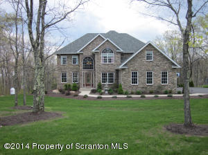 Set on a beautifully landscaped 1.05 acres.