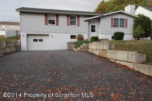 Lots of parking, 1 car garage, well built retaining wall, blacktop driveway!