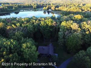 Home plus 14 ponds on 106+/- acre property!