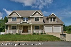Welcome to this beautiful custom home in in Carbondale Twp.