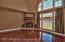 The dramatic two story great room/family room features a magnificent wall of windows that shows off the backyard