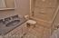 This hall bathroom serves the two bedrooms at this end of the hall, bedrooms three and four