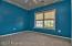This rear facing bedroom, bedroom four is painted a cheerful teal