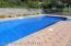 Fully fenced yard around pool.