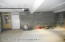 Oversized 2 car garage with room for tools, mowers, pool equipment, etc.