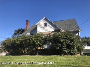 Cape cod with wood siding and stonework