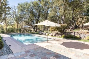 Your new backyard ..... over 1/2 acre. Auto Retractible Pool Cover w/large beach entry.