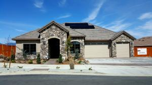 10 SOLAR PANEL SYSTEM, TILE ROOF, EXTERIOR ROCK/STONE AND 8' INSULATED GARAGE DOORS