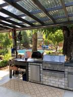Outdoor Kitchen includes BBQ, Fridge, and Sink