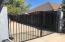 FRONT YARD GATE TIES INTO BACKYARD WHERE SPACIOUS RV PARKING IS LOCATED