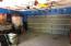 SINK & WORKBENCH INSIDE GARAGE & ROOM FOR A LARGE SAFE