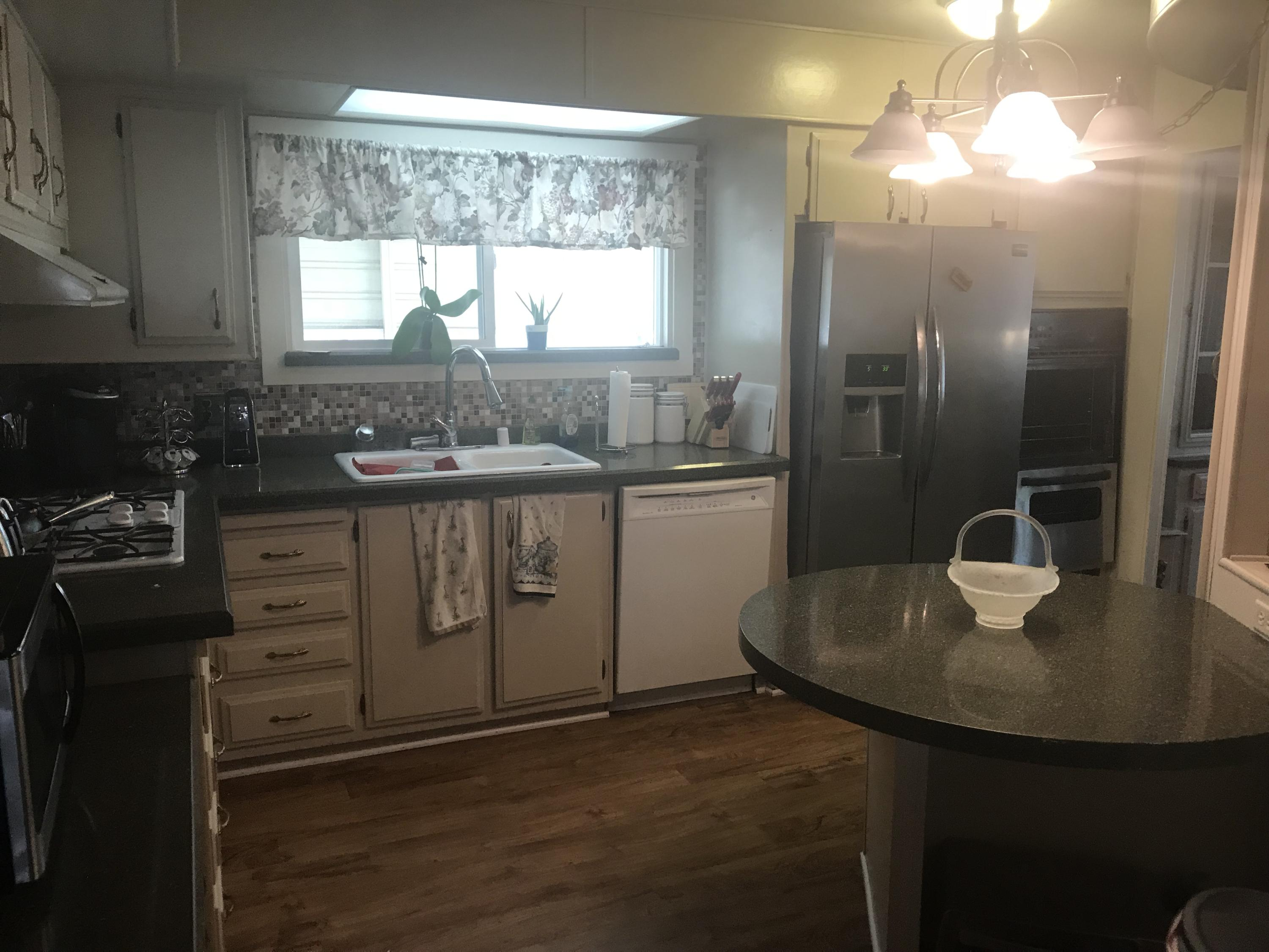 Nicely Updated Manufactured Home On Permanent Foundation In North Redding.  Laminate Floors Throughout, Granite Countertops In Kitchen.