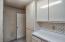 Large Indoor Laundry room with lots of storage!