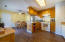 Dining area with pantry and open kitchen.