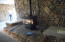 beautiful rock hearth with two covered storage areas on either side of propane stove..