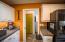 Kitchen to garage, laundry, pantry