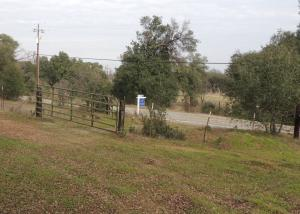 gated entrance off Hooker Creek with power at road