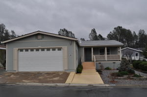Nice curb appeal with attached 2 car garage and covered front porch