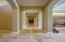 Travertine floors, beautiful arches, impressive hallway