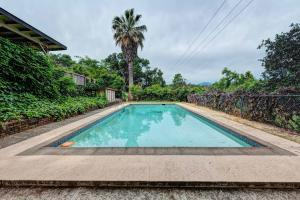 Enjoy the summer days by the pool offering plenty of privacy.