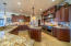 Main floor gourmet kitchen with built in fridge/freezer and double oven commercial stove.