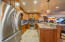 This kitchen serves the game room, family room, executive office, theater room as well as the indoor gym/pool area and the outside pool. Complimented by a full wine cellar.