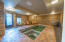Indoor swim spa with attached home gym and sauna.