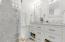 quartz shower and lots of cabinet storage
