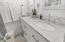 guest bathroom offers dual vanity