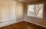 Street level, second floor bedroom 2. Hardwood floors