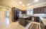 Built-in custom fridge, SS Bosch Dishwasher, island, custom cabinetry.